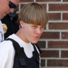 Police lead suspected shooter Dylann Roof into the courthouse in Shelby, North Carolina