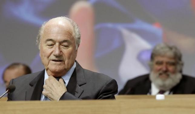 A file picture shows FIFA President Blatter standing in front of executive member Blazer of the U.S. during the 61st FIFA congress in Zurich