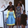 First Lady Michelle Obama, Malia Obama (C), Sasha Obama (R) and her mother Marian Robinson