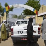 Security officers stand at the site of a suicide bombing in Ndjamena