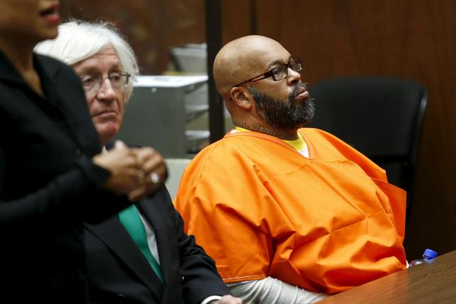"""Defendant Marion """"Suge"""" Knight looks on as he attends a hearing with his attorney Thomas Mesereau in his robbery case in Los Angeles, California"""