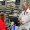Pharmacy Manager at a Tampa, Florida Wal-Mart, completes a transaction with a customer