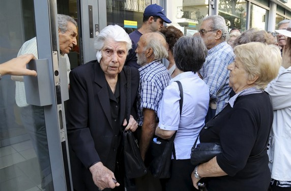 greece - People line up outside a National Bank branch