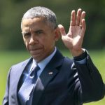 U.S. President Barack Obama waves as he walks from the Oval Office of the White House in Washington