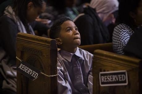 A child listens to a speech