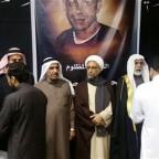Sheikh Hassan al-Saffar, a top Shiite cleric from Qatif, center