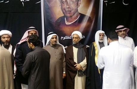 Sheikh Hassan al-Saffar, a top Shiite cleric from Qatif, center
