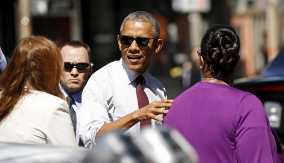 U.S. President Barack Obama arrives at a restaurant to meet with formerly incarcerated individuals who have previously received commutations from his and previous administrations in Washington