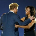 Prince Harry, left, Michelle Obama