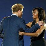 Prince Harry, left, Michelle Obama